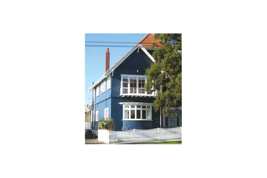 Exterior weatherboards finished in Resene Sonyx 101 CoolColour tinted to Resene Crescendo, deep blue