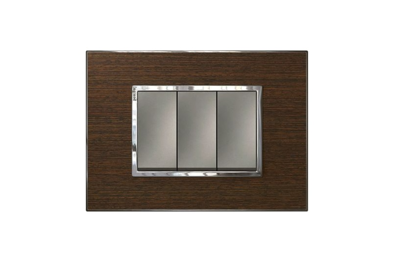 Arteor light switch in wenge style wood