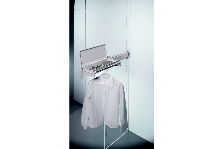 Ambos side-mounted jacket rack with accessory drawer.