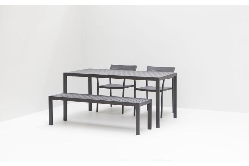 The Eos bench is a versatile outdoor bench made from powder-coated aluminium that won't rust over time with plastic floor glides