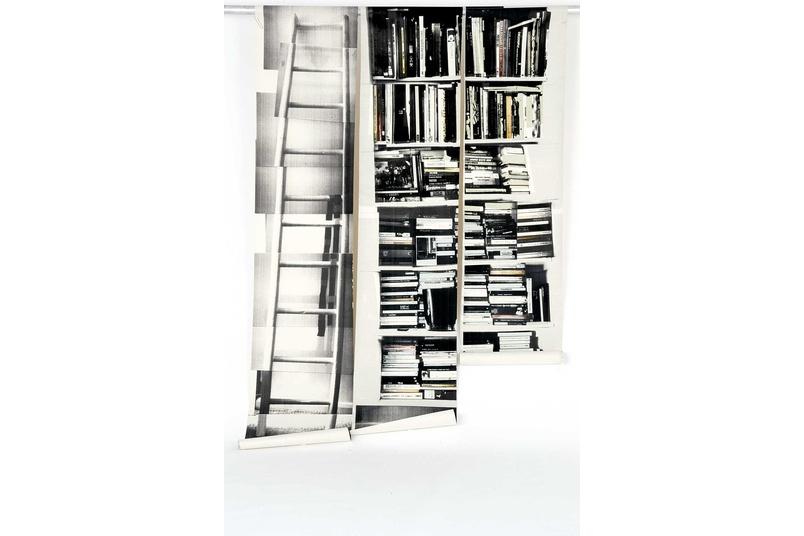 Fake bookshelf wallpaper designed by Deborah Bowness
