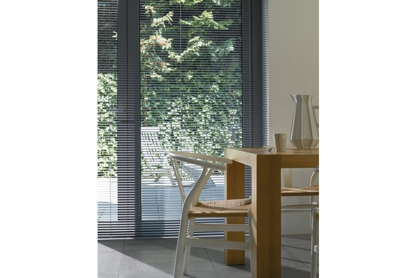 You can operate Luxaflex aluminium venetians manually - a cord system lifts them up and down, while a twistable wand opens and closes the slats.
