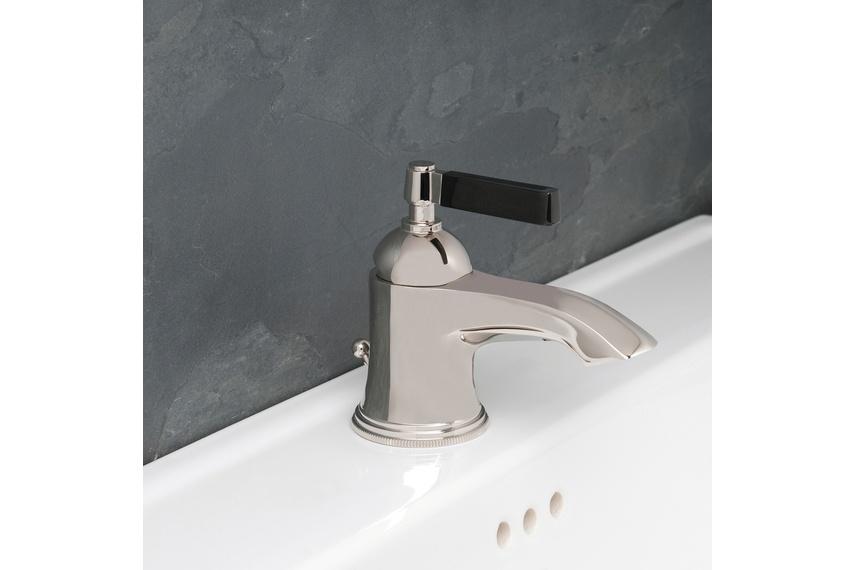 Style Moderne basin mixer.