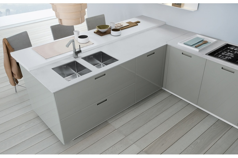 Features etched glass benchtops and doors in glass with beautiful cut-out handle detailing.