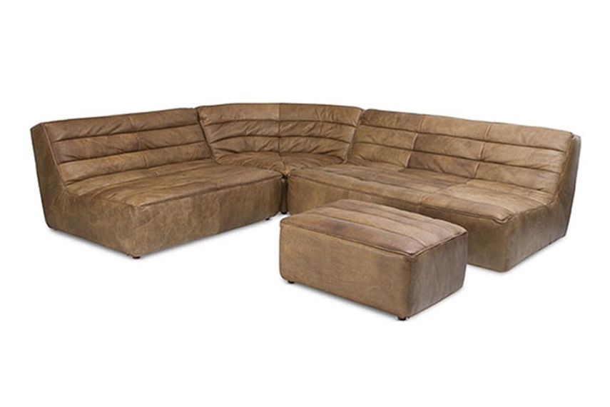 The Shabby sofa is cushioned with ribbed sewing