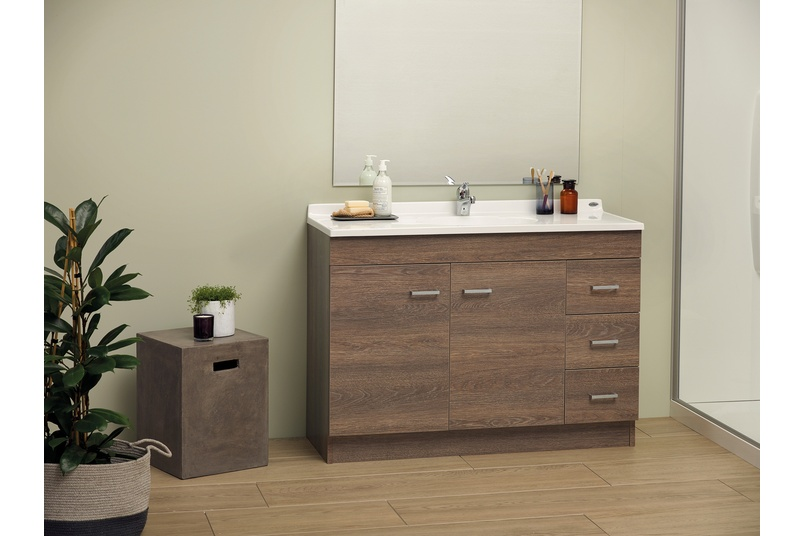 Statesman classic floor standing vanity in Manor Oak.