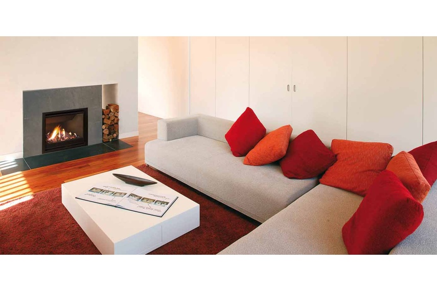 Escea AF700 gas fireplace (Volcanic Black Slim fascia and logs fuel bed).